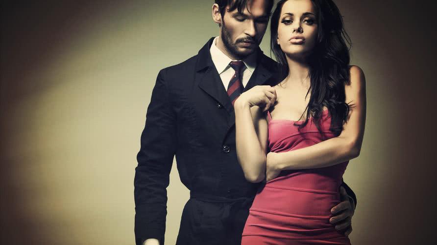 woman-wearing-pink-dress-and-man-wearing-suit.jpg
